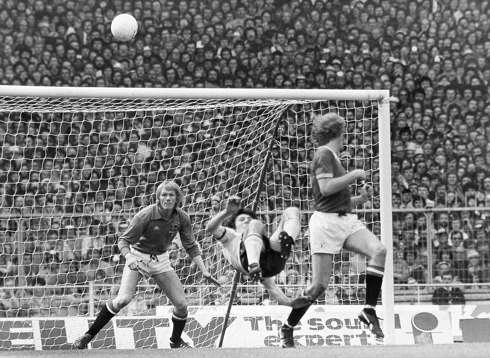 Arsenal striker Frank Stapleton tries an overhead kick during the 1979 FA Cup final, but Manchester United's goalkeeper Gary Bailey wasn't called upon as the shot went over the crossbar