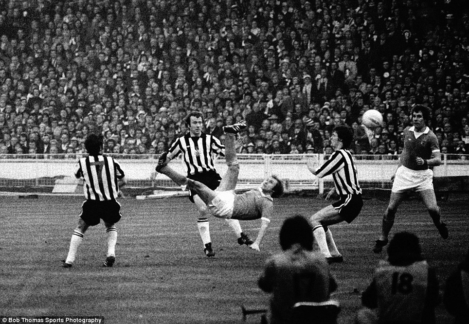 Manchester City's Dennis Tueart (3rd left) scores the winning goal with an overhead kick during the 1976 League Cup final against Newcastle at Wembley