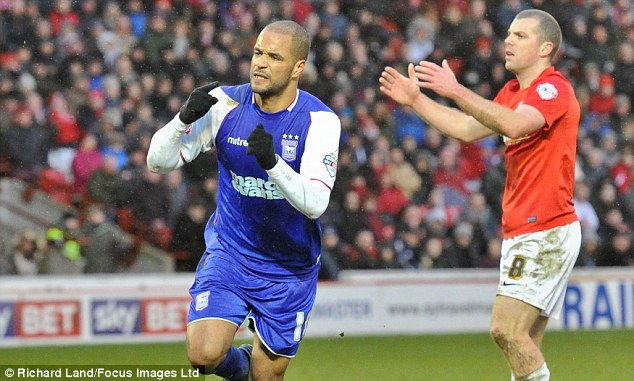 Leveller: David McGoldrick (left) wheels away to celebrate grabbing Ipswich's equalising goal