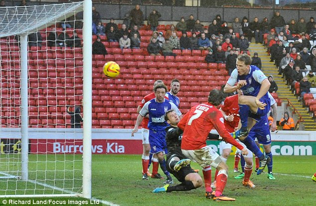 Back in it: Christophe Berra (right) volleys Ipswich back into the game at Oakwell