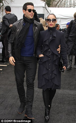 Side by side: The pair were making an appearance at the event on a chilly day in New York City, with Cara wrapping up in a distinctive winter coat