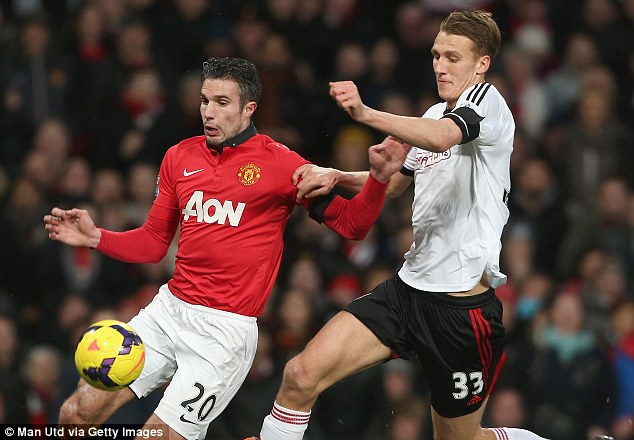 Big future: Dan Burn gets to grips with Robin van Persie during Fulham's 2-2 draw at Manchester United