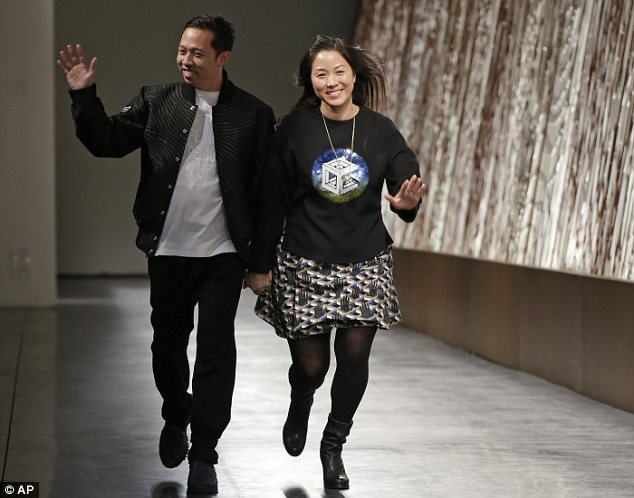The creators: Opening Ceremony's co-creative directors Humberto Leon (left) and Carol Lim (right) take their final bow at Sunday night's runway show