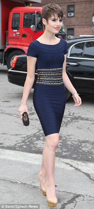 On-trend: The Blue Bloods star wore a midnight blue bodycon dress with an embellished waist detail, completing the look with a pair of nude heels