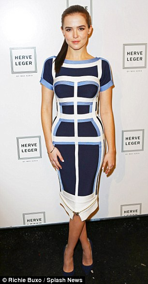 Standing tall: Zoey Deutch wore a striped blue bodycon dress