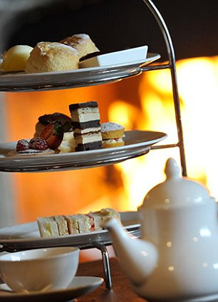 Tea for three: Scones and a pot of tea by the fire...bliss
