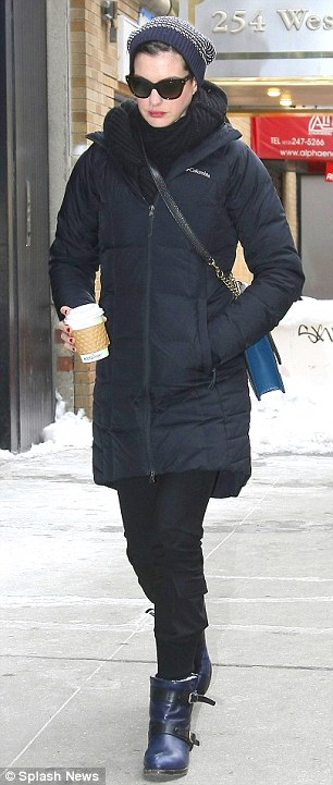 Warm coffee! Anne carried a toasty drink in one hand while tucking the other in her pocket