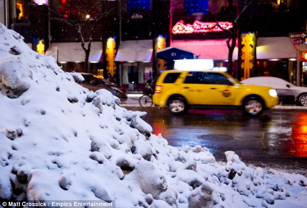 Snow end in sight: Sunday night's snowfall added to piles of snow and ice that accumulated last week