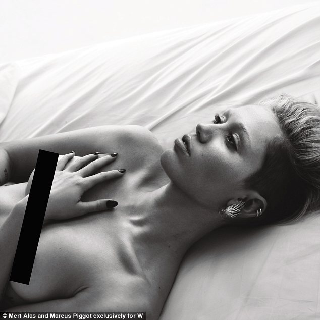 Exposed: Miley Cyrus bares her breasts in a racy new photo shoot for W Magazine's March 2014 issue