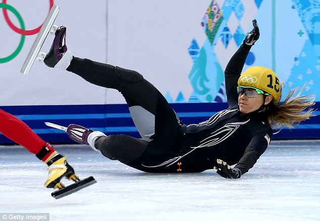 Skidding out: American speedskater Jessica Smith appears to have touched skates with a Russian competitor who was coming up behind her in a curve