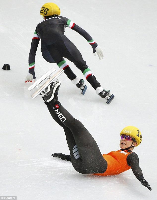 Slip up: Sanne van Kerkhod of the Netherlands slides on his back after a fall