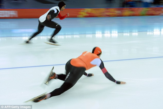 Tripping forward: Netherland's Stefan Groothuis slips and falls on the ice