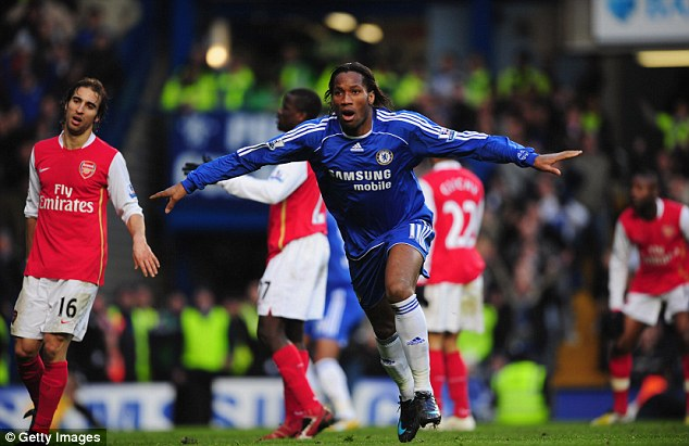 Down and out: Didier Drogba of Chelsea celebrates as Arsenal's title challenge hit a wall in 2008