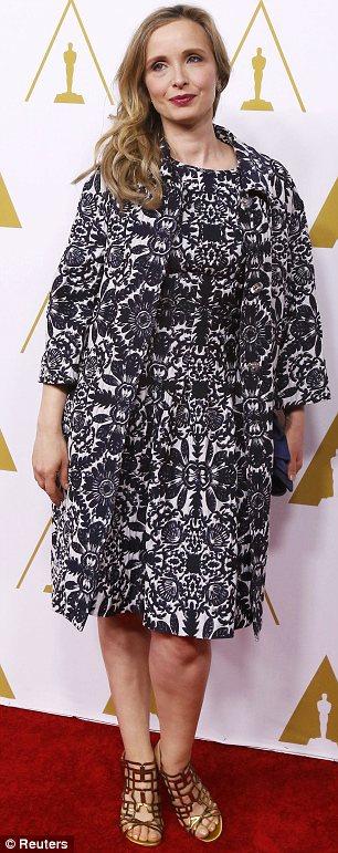 Marvellous in monochrome: Julie Delpy chose an elegant look in the form of a black and white printed coat and dress. She was joined at the event by Before co-star Ethan Hawke (R)