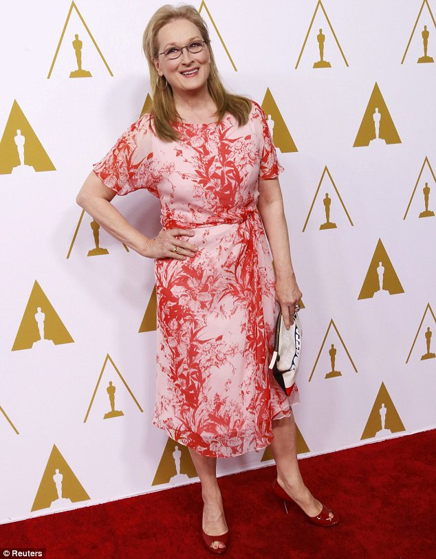 Youthful: Meryl Streep looked far younger than her 64 years in a playful pink and red dress in lightweight fabric