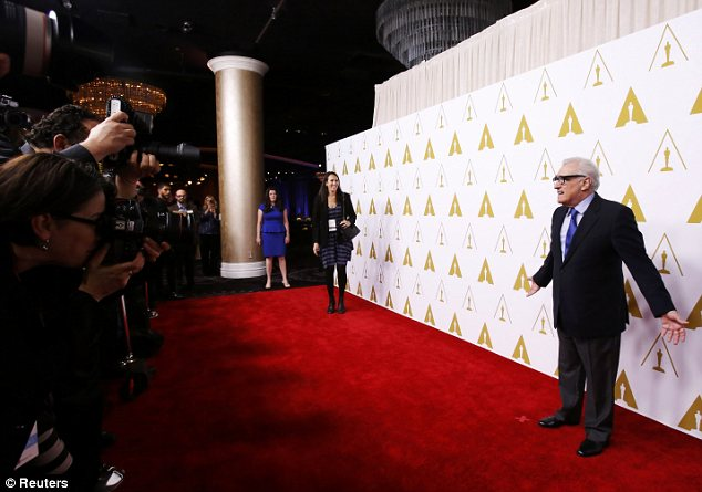 What do I do?: Martin Scorsese, also up for Best Director for Wolf Of Wall Street, looked a little confused by photographers' instructions on the red carpet