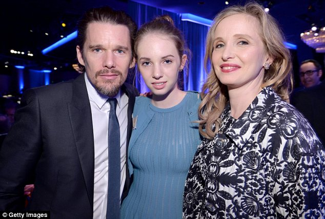 His mini-me: Ethan and Julie posed with his 15-year-old daughter Maya from his marriage to Uma Thurman