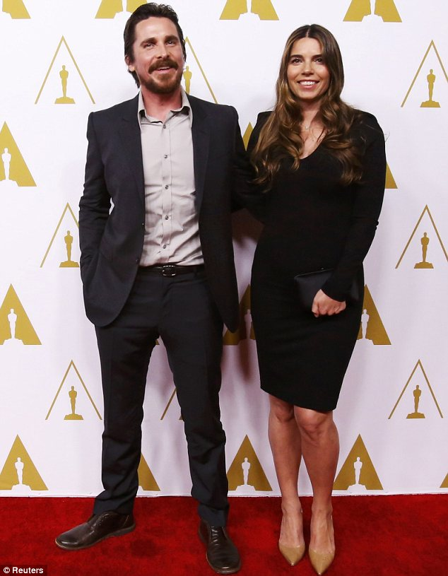 Happy couple: Christian Bale, who is also a Best Actor nominee, arrived with his glamorous wife Sibi Blazic