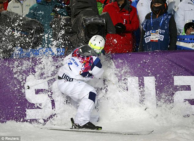 Caught on camera: Canada's Mikael Kingsbury crashes as he competes during the men's freestyle skiing moguls competition