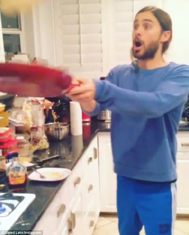 Showing off: Jared displayed his cooking skills as he flipped pancakes in his kitchen
