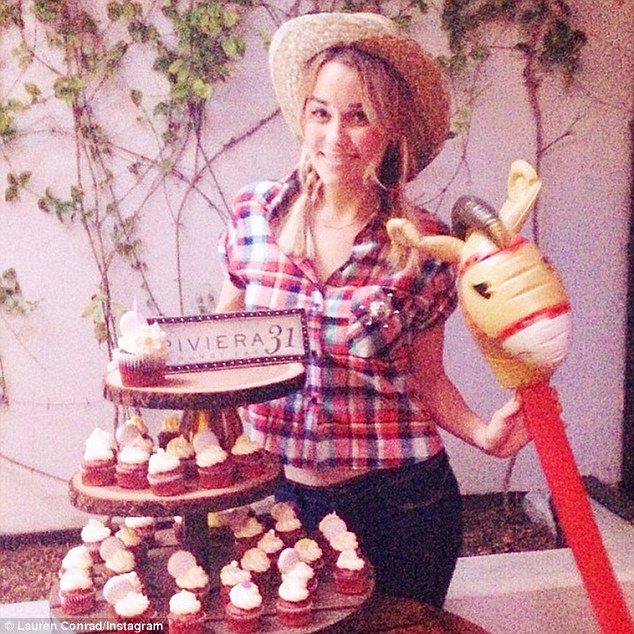 Happy birthday! Lauren Conrad threw a charming joint birthday party for her and fiancé William Tell on Friday - pictured here at the country-western themed party