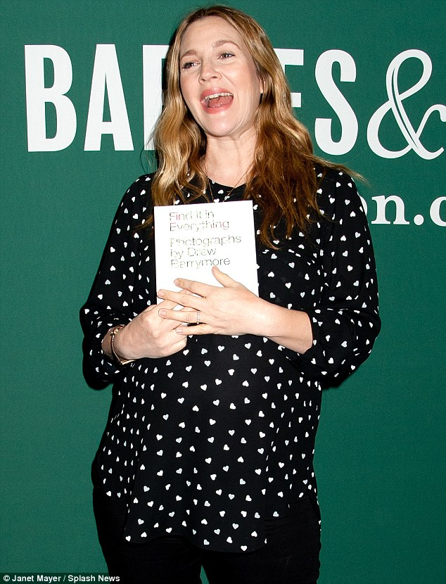 Things that go bump in the night: Proud Drew revelled in flaunting both her book and her bump at the event