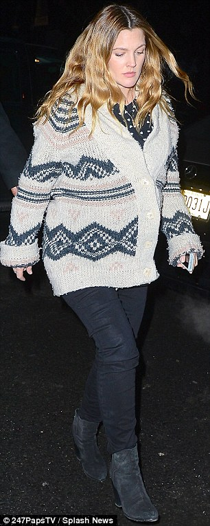 Wrapped up: Drew covered up her bump in a knitted Aztec-style cardigan as she headed out to dinner after the signing