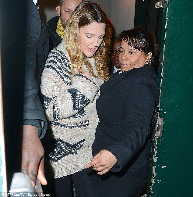 Mind the bump! Drew Barrymore's pregnancy curves caused issues as she got stuck in the door while leaving her book signing in Union Square, New York, on Monday night