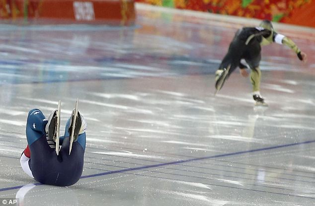 Left behind: Australia's Daniel Greig, left, crashes in the first heat of his men's 500-meter speedskating race against Yuya Oikawa of Japan