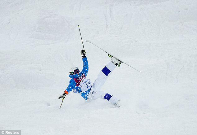 Pulling shapes: Mogul skiier Ville Miettunen of Finland crashes