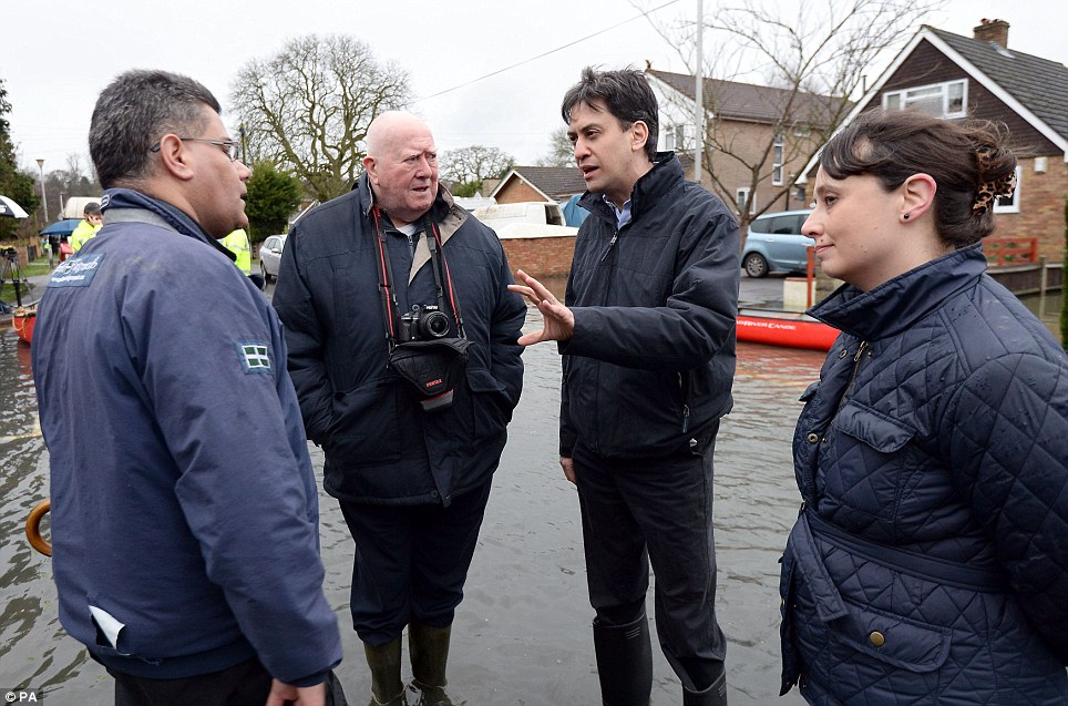 Visit: Labour leader Ed Miliband (2nd right) speaks with Alok Sharma MP for Reading West (left) Victoria Groulef (right), Labour's Parliamentary Candidate for Reading West, and parish councilor John Chapman (2nd left) in Purley on Thames