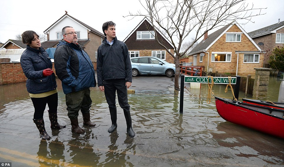 Looking out: Labour leader Ed Miliband (right) and Victoria Groulef (left), Labour Parliamentary Candidate, speak with resident Adrian North (centre) in Purley on Thames