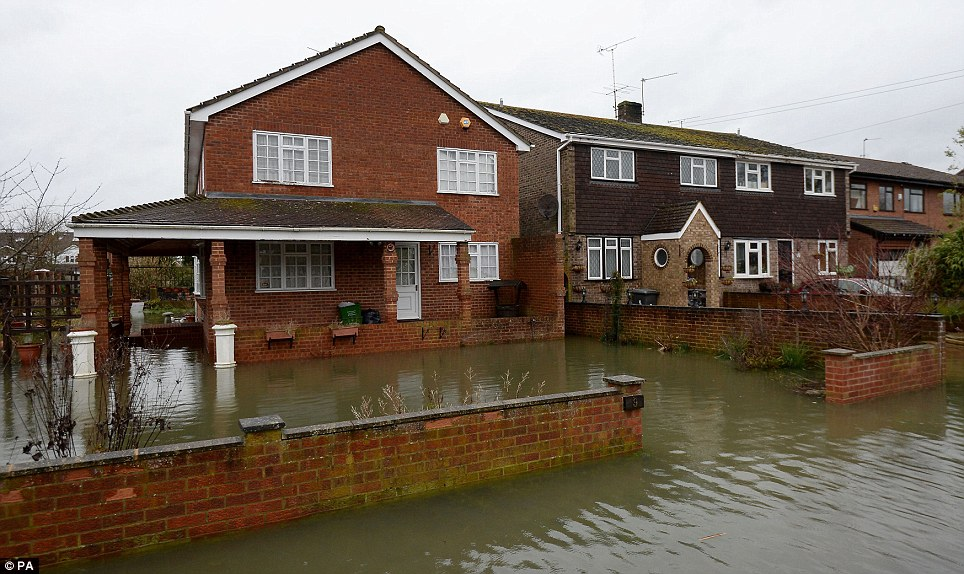 Troubled area: A flooded street in Purley on Thames, Berkshire, which has been devastated after the Thames burst its banks