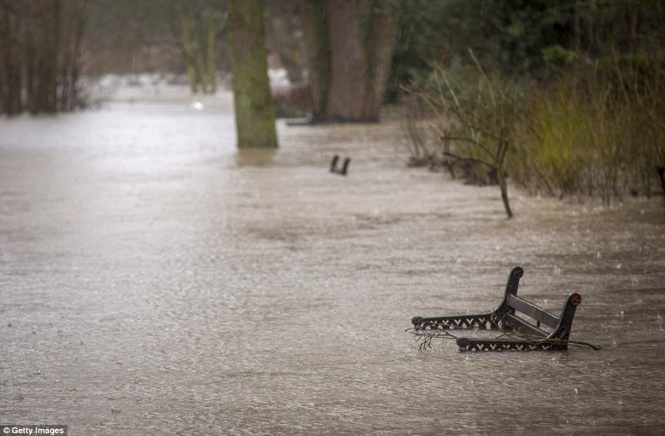 No sitting down: A bench is submerged in floodwater on Bromwich Parade on the banks of the River Severn in Worcester