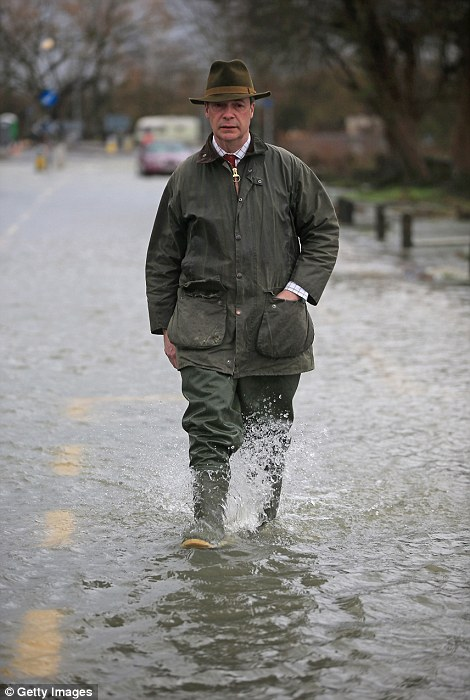 Leader of UKIP Nigel Farage tours flooded properties  and roads as he visits Chertsey
