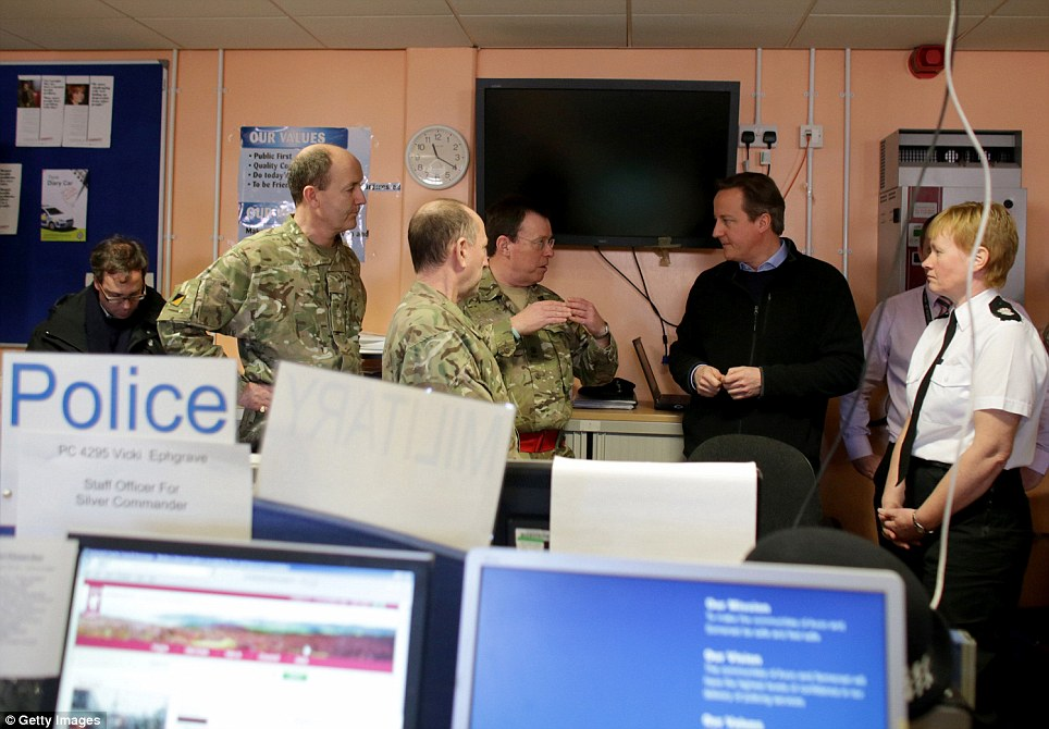 Visit: Prime Minister David Cameron talks to Army reservists as he is shown the multi-agency run Silver Command control room at Taunton Command Centre in Somerset