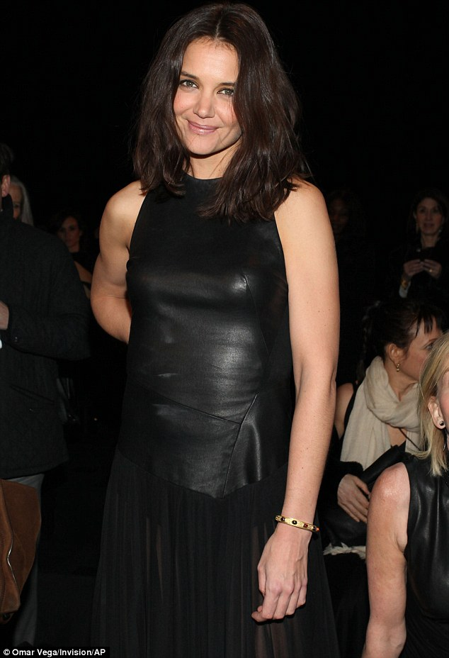 Leather bound: Katie looked simply stunning in her DKNY outfit, as she smiled for photographers at the star-studded show