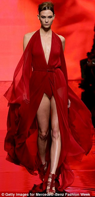 Lady in red: Model Karlie Kloss looked absolutely flawless as she strutted down the runway