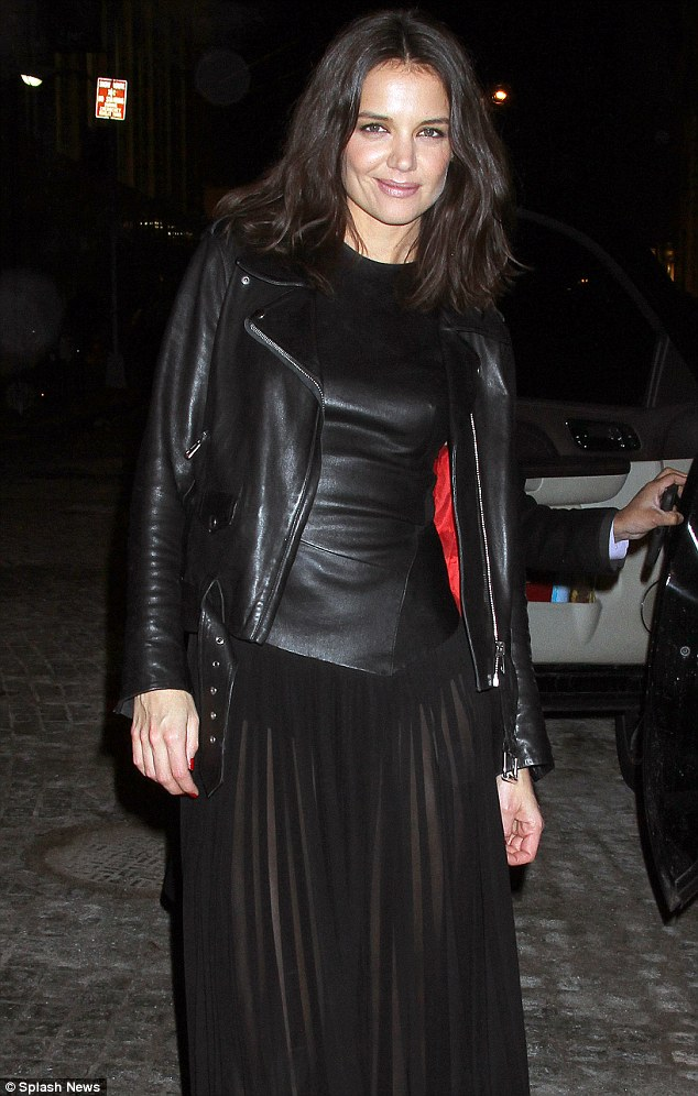 Style win: Katie added a leather jacket to her ensemble once outside of the event