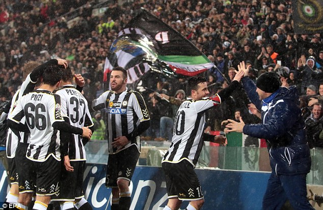 Within touching distance: Udinese will defend a 2-1 advantage at Fiorentina in the second leg of their Coppa Italia semi-final. Here, Antonio Di Natale celebrates his first leg strike with the fans