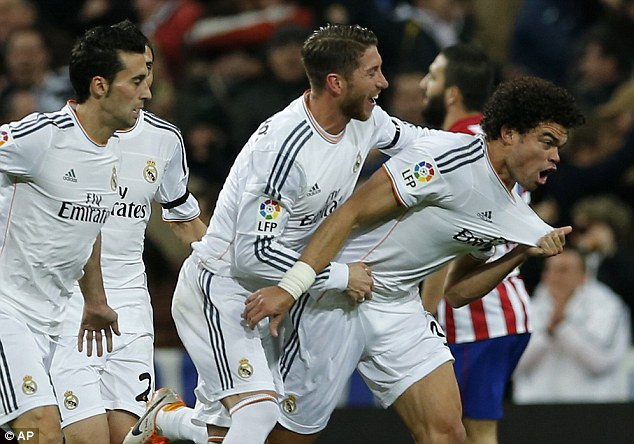 Big advantage: Pepe (right) is mobbed by his Real Madrid teammates after scoring during the first leg of their Copa del Rey semi-final with city rivals Atletico