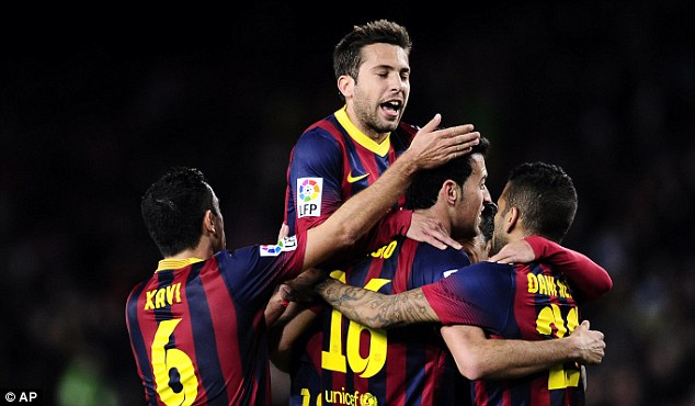 In the box seat: Barcelona beat Real Sociedad 2-0 in the first leg, with Sergio Busquets (second right) on target