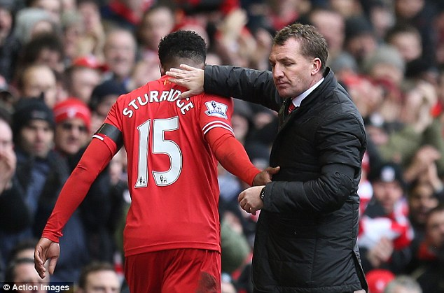 Well-played: Brendan Rodgers congratulates striker Daniel Sturridge after his superb performance against Arsenal