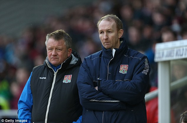 Uphill struggle: Northampton Town manager Chris Wilder (left) and assistant Alan Knill look on during the weekend's defeat to Plymouth Argyle