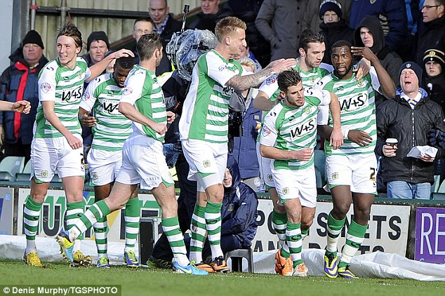 Short-lived joy: Yeovil celebrate Ishmael Miller's goal against Leeds United at the weekend, but they ultimately lost 2-1 and remain bottom of the Championship