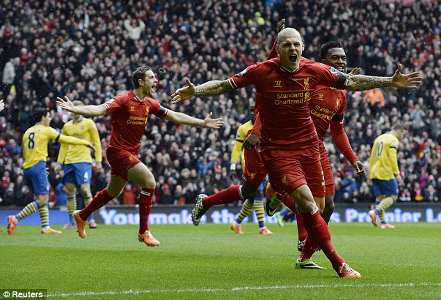 Delight: Liverpool were outstanding in their 5-1 demolition of Arsenal at the weekend, with defender Martin Skrtel scoring twice