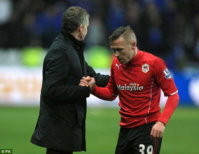 Hurting: Ole Gunnar Solskjaer and Craig Bellamy after Cardiff's 3-0 defeat to Swansea in the South Wales Derby on Satrurday