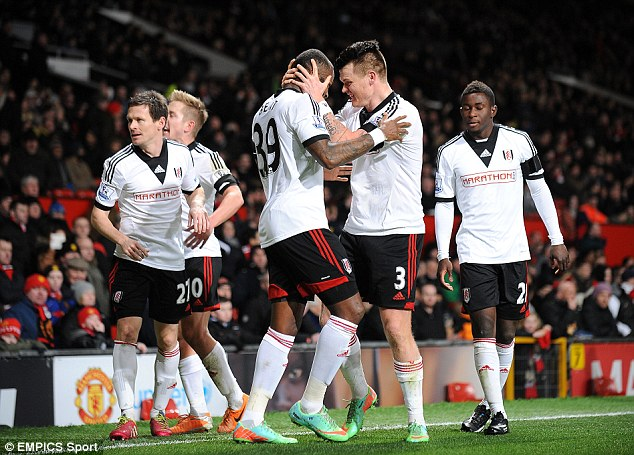 Light at the end of the tunnel? Fulham celebrate their equalising goal, scored by Darren Bent, at Old Trafford on Sunday