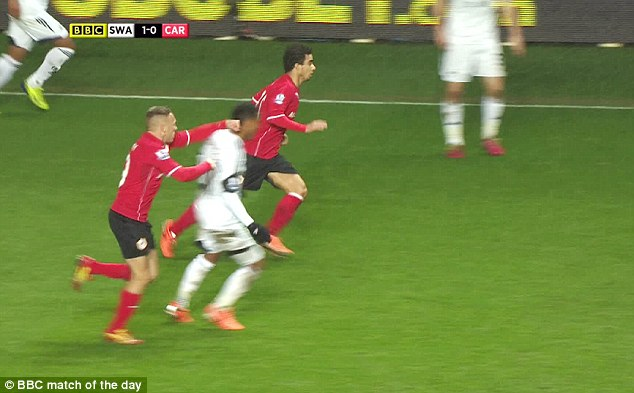 Punished: Craig Bellamy is set to receive a three-match ban for this punch on Jonathan de Guzman