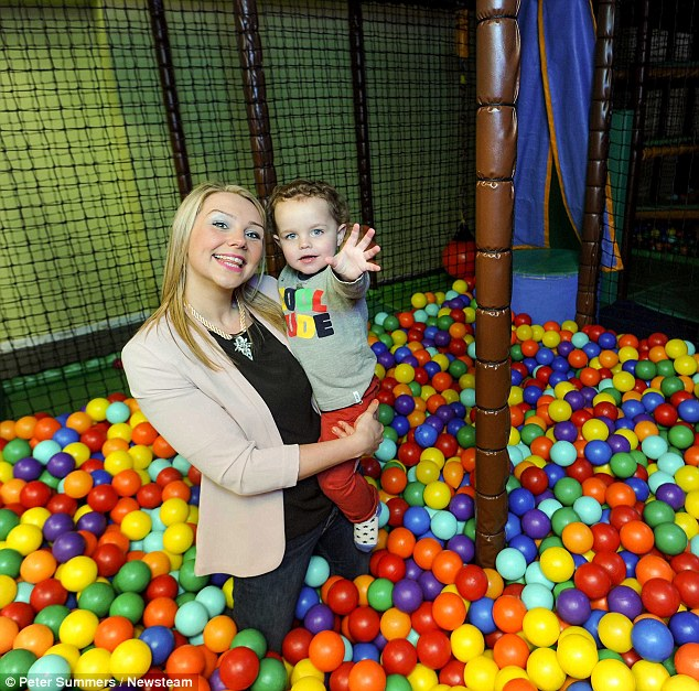 Child's play: Emma, pictured with her 2-year-old son Freddie Jones at Rocco's Play Centre, was mortified after getting stuck in between two rollers